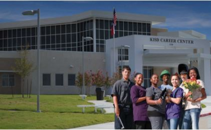 A group of students pose for a picture outside of the KISD Career Center building