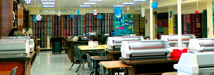 A photo of the Media Center - Printers on tables and walls filled with color paper