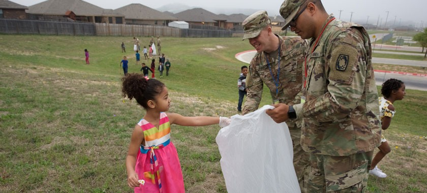 Haynes Elementary students and Fort Hood soldiers pick up trash.