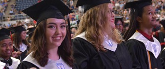 Picture of students on their graduation day wearing their caps and gowns.
