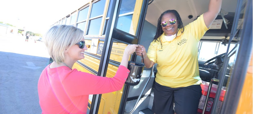 Nolan MS administrators give goodies to drivers