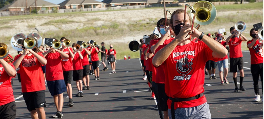 Harker Heights High School Red Brigade band practices marching.