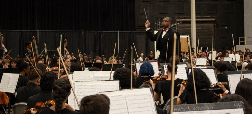 Heights High Director leads his orchestra in 'Waltz of the Flowers'