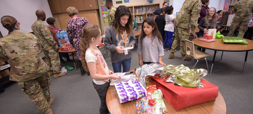 Soldiers deliver toys to school