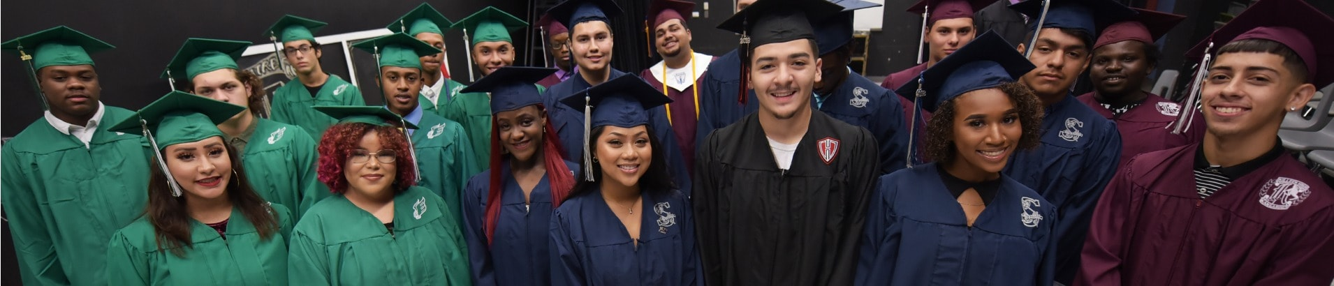Students in their cap and gown on the day of their High School graduation.