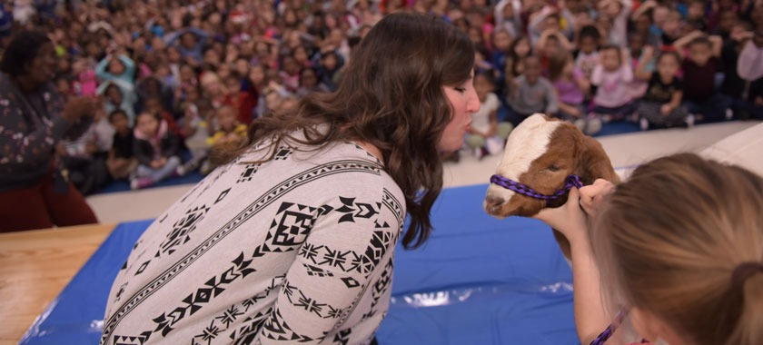 Willow Springs principal kisses goat