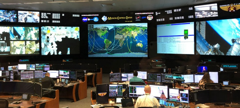 Engineers and scientists work in the Mission Control Center in Houston.