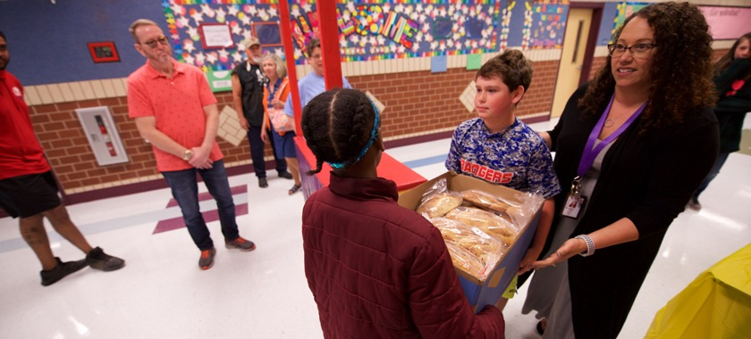 Elementary students learned to bake bread and made loaves for charity.