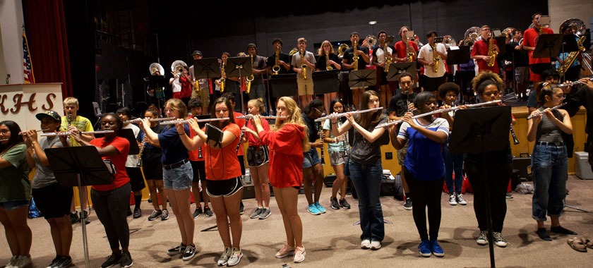 Combined band rehearses for convocation