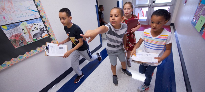 Clarke third-graders react to clues during scavenger hunt.