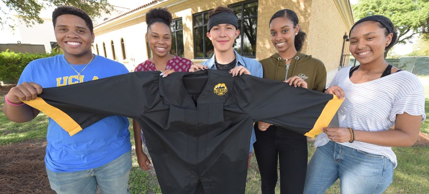 Early College seniors show off graduation gown