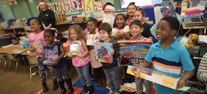 A local business brought toys to every child at West Ward.