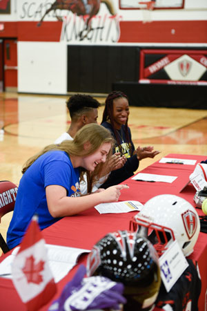 Jenny Saylor signs her letter of intent to play for Jarvis Christian College
